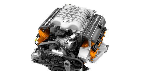 Product, Technology, Orange, Amber, Font, Machine, Space, Electronic component, Engine, Automotive engine part,