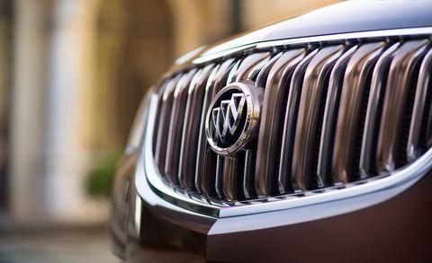 Product, Automotive exterior, Grille, Automotive design, Light, Logo, Luxury vehicle, Metal, Close-up, Brand,