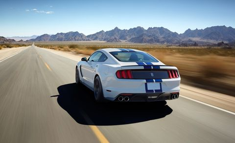 Tire, Road, Mode of transport, Automotive design, Vehicle, Automotive lighting, Infrastructure, Mountainous landforms, Vehicle registration plate, Performance car,