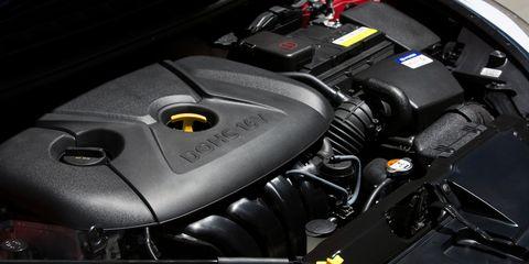 Automotive design, Engine, Automotive exterior, Personal luxury car, Luxury vehicle, Carbon, Automotive engine part, Kit car, Automotive super charger part,
