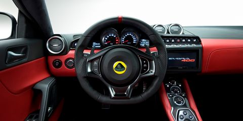 Motor vehicle, Steering part, Mode of transport, Automotive design, Steering wheel, Red, Center console, Speedometer, Car, Luxury vehicle,