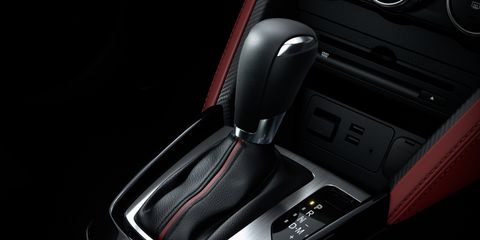 Automotive design, Fixture, Gear shift, Vehicle door, Luxury vehicle, Personal luxury car, Center console, Carbon, Car seat, Gloss,