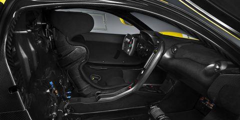 Motor vehicle, Automotive design, Luxury vehicle, Personal luxury car, Steering wheel, Steering part, Carbon, Supercar, Sports car, Vehicle door,