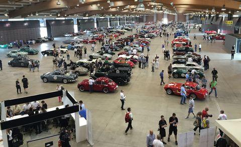 Motor vehicle, Automotive design, Car, Crowd, Auto show, Exhibition, Antique car, Hall, Classic car, Luxury vehicle,