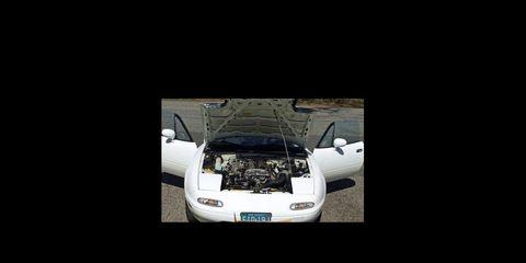 Motor vehicle, Automotive exterior, Automotive design, Automotive lighting, Grille, Automotive mirror, Automotive side-view mirror, Bumper, Windshield, Vehicle door,
