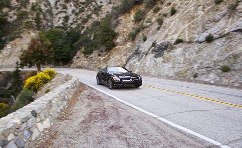 Road, Automotive design, Land vehicle, Infrastructure, Automotive mirror, Car, Rim, Road surface, Automotive lighting, Alloy wheel,