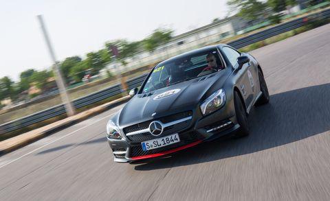 Mode of transport, Automotive design, Vehicle, Automotive mirror, Grille, Road, Performance car, Car, Hood, Asphalt,