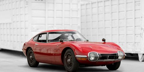Tire, Wheel, Mode of transport, Automotive design, Car, Red, Classic car, Automotive tire, Rim, Fender,