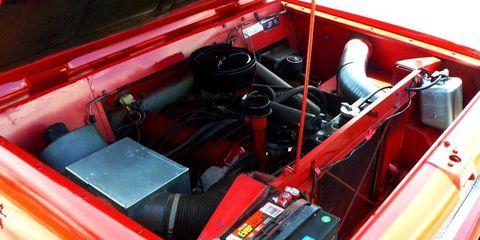 Motor vehicle, Engine, Wire, Cable, Fuel line, Kit car, Automotive engine part, Nut, Vintage car, Steering wheel,