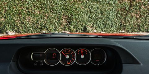Motor vehicle, Mode of transport, Automotive design, Glass, Windshield, Steering wheel, Gauge, Steering part, Speedometer, Automotive window part,
