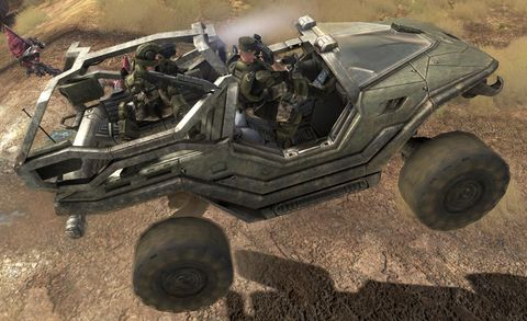 Motor vehicle, Soldier, Automotive tire, Military person, Helmet, Camouflage, Automotive wheel system, Military vehicle, Tread, Military uniform,
