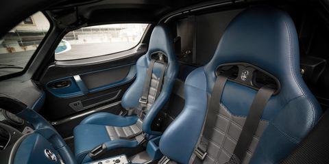 Motor vehicle, Automotive design, Car seat, Vehicle door, Steering wheel, Car seat cover, Automotive mirror, Steering part, Automotive side-view mirror, Automotive window part,