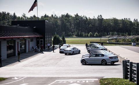 Land vehicle, Flag, Road, Car, Automotive parking light, Road surface, Rim, Alloy wheel, Asphalt, Automotive tire,