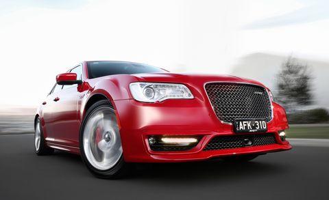 Tire, Automotive design, Vehicle, Automotive lighting, Hood, Grille, Car, Red, Headlamp, Rim,