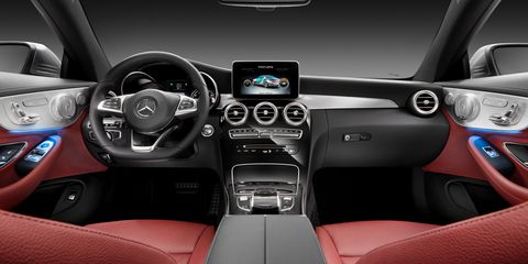 Motor vehicle, Steering part, Mode of transport, Automotive design, Product, Steering wheel, Vehicle audio, Center console, White, Car,
