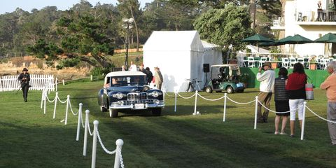 Car, Classic car, Antique car, Chair, Pole, Tent, Lawn, Classic, Luxury vehicle, Outdoor table,