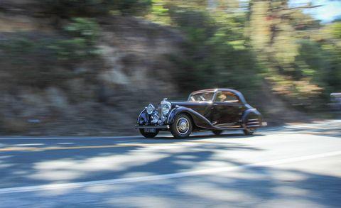 Tire, Wheel, Automotive design, Classic car, Rim, Fender, Automotive wheel system, Antique car, Automotive tire, Classic,