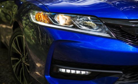 Blue, Automotive design, Daytime, Automotive lighting, Vehicle, Headlamp, Hood, Automotive exterior, Grille, Car,