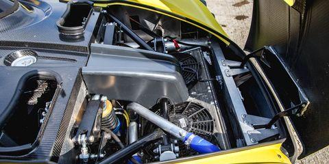 Motor vehicle, Automotive design, Yellow, Automotive exterior, Engine, Hood, Automotive engine part, Automotive super charger part, Grille, Kit car,