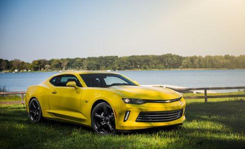 Tire, Motor vehicle, Wheel, Automotive design, Vehicle, Yellow, Automotive tire, Hood, Chevrolet camaro, Rim,