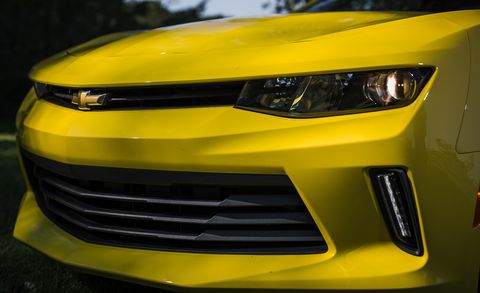 Motor vehicle, Automotive design, Daytime, Green, Yellow, Hood, Vehicle, Headlamp, Automotive lighting, Grille,