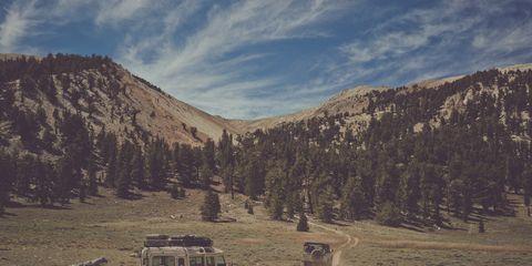 Wheel, Mountainous landforms, Automotive tire, Highland, Fender, Automotive exterior, Valley, Tread, Mountain, Off-road vehicle,