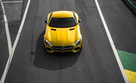 Motor vehicle, Mode of transport, Automotive design, Yellow, Vehicle, Automotive mirror, Road, Performance car, Car, Hood,