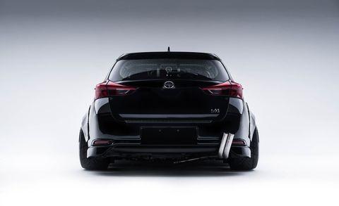Automotive design, Automotive tail & brake light, Vehicle, Automotive exterior, Car, Automotive lighting, Hatchback, Bumper, Luxury vehicle, Trunk,