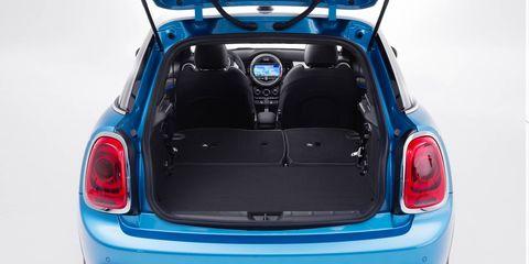 Motor vehicle, Automotive design, Blue, Mode of transport, Vehicle, Automotive tail & brake light, Trunk, Car, Red, Automotive exterior,