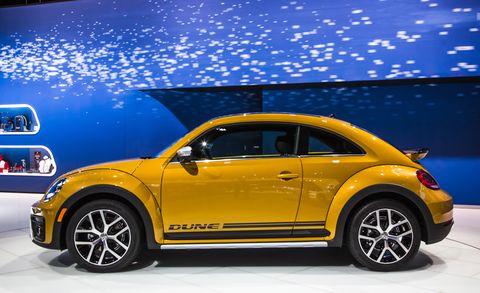 Tire, Automotive design, Yellow, Vehicle, Car, Rim, Fender, Alloy wheel, Automotive tire, Automotive wheel system,