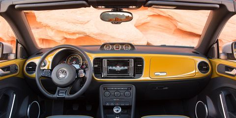 Motor vehicle, Steering part, Mode of transport, Automotive mirror, Steering wheel, Automotive design, Product, Brown, Vehicle audio, Center console,
