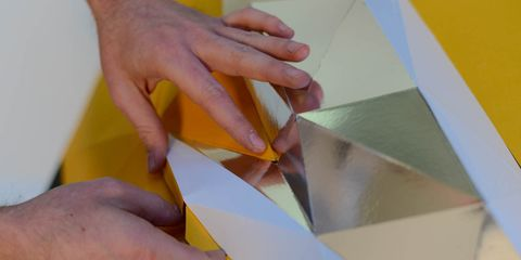 Finger, Yellow, Nail, Paper product, Paper, Orange, Wrist, Material property, Creative arts, Craft,
