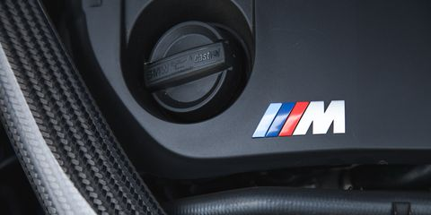 Motor vehicle, Automotive design, Automotive exterior, Logo, Grey, Carbon, Symbol, Close-up, Cable, Trademark,