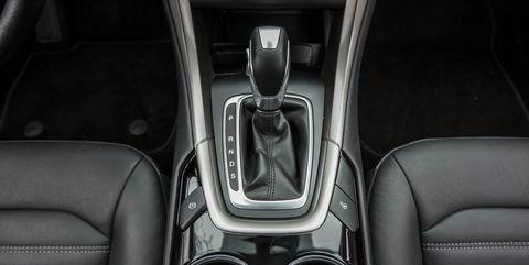Land vehicle, Vehicle, Car, Gear shift, Center console, Luxury vehicle, Executive car,