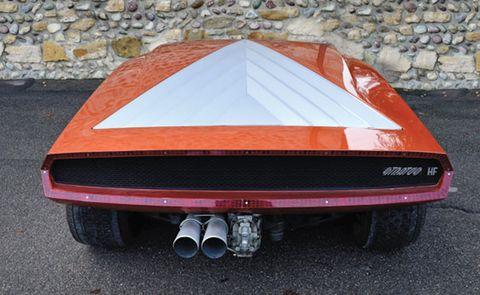 Automotive design, Automotive exterior, Red, Car, Road surface, Fender, Bumper, Sports car, Hood, Automotive exhaust,