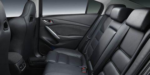 Motor vehicle, Mode of transport, Automotive design, Car seat, Vehicle door, Car seat cover, Head restraint, Fixture, Leather, Luxury vehicle,
