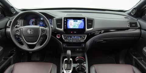 Motor vehicle, Product, Blue, Steering part, Automotive design, Steering wheel, Center console, Vehicle audio, Car, Electronic device,