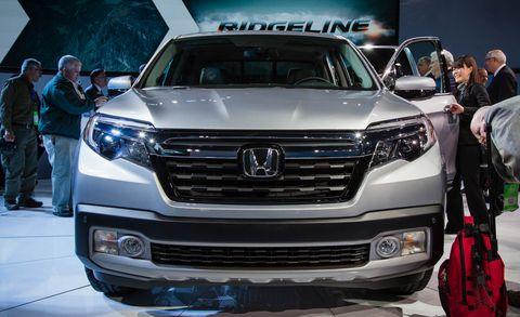 Automotive design, Vehicle, Land vehicle, Event, Grille, Car, Headlamp, Luxury vehicle, Auto show, Personal luxury car,