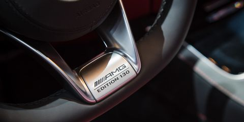 Motor vehicle, Automotive design, Logo, Carbon, Gloss, Motorcycle accessories, Scooter,