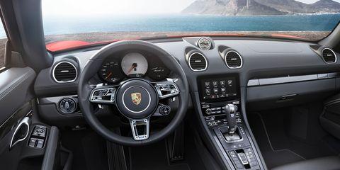 Motor vehicle, Steering part, Mode of transport, Steering wheel, Transport, Automotive design, Center console, White, Speedometer, Vehicle audio,