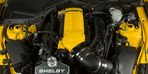 Motor vehicle, Yellow, Engine, Automotive engine part, Machine, Automotive fuel system, Automotive super charger part, Nut,