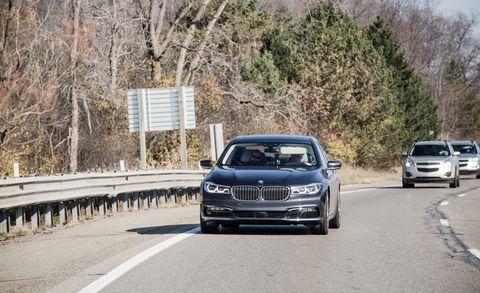 Tire, Road, Vehicle, Land vehicle, Infrastructure, Automotive design, Automotive exterior, Vehicle registration plate, Grille, Car,