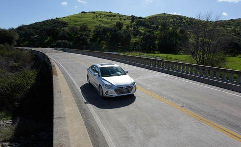 Motor vehicle, Road, Automotive design, Vehicle, Automotive mirror, Road surface, Infrastructure, Asphalt, Headlamp, Grille,