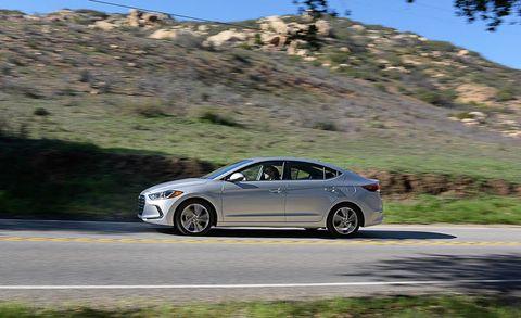 Tire, Road, Mode of transport, Vehicle, Automotive design, Alloy wheel, Rim, Car, Asphalt, Full-size car,