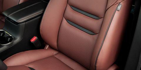 Motor vehicle, Car seat, Car seat cover, Luxury vehicle, Head restraint, Leather, Vehicle door, Personal luxury car, Gear shift, Seat belt,