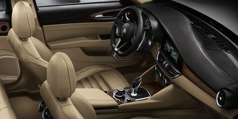 Motor vehicle, Automotive design, Steering part, Car, Steering wheel, Personal luxury car, Center console, Luxury vehicle, Vehicle door, Car seat,