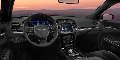 Motor vehicle, Automotive design, Steering part, Transport, Steering wheel, Center console, Vehicle audio, Automotive mirror, White, Car,