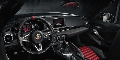 Motor vehicle, Mode of transport, Automotive design, Steering part, Steering wheel, Speedometer, Red, Center console, Gauge, Trip computer,