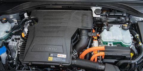 Engine, Automotive engine part, Luxury vehicle, Automotive air manifold, Fuel line, Personal luxury car, Automotive super charger part, Kit car, City car, Nut,