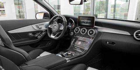 Motor vehicle, Mode of transport, Steering part, Automotive design, Transport, Vehicle, Steering wheel, White, Center console, Glass,